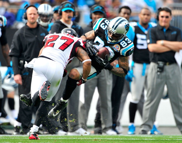 CHARLOTTE, NC - DECEMBER 09: Robert McClain #27 of the Atlanta Falcons upends Louis Murphy #83 of the Carolina Panthers during play at Bank of America Stadium on December 9, 2012 in Charlotte, North Carolina. (Photo by Grant Halverson/Getty Images)