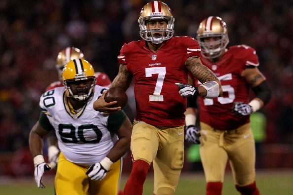 SAN FRANCISCO, CA - JANUARY 12: Quarterback Colin Kaepernick #7 of the San Francisco 49ers runs the ball against nose tackle B.J. Raji #90 of the Green Bay Packers during the NFC Divisional Playoff Game at Candlestick Park on January 12, 2013 in San Francisco, California. (Photo by Stephen Dunn/Getty Images)
