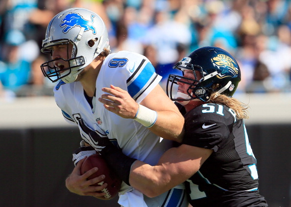 JACKSONVILLE, FL - NOVEMBER 04: Matthew Stafford #9 of the Detroit Lions is tackled by Paul Posluszny #51 of the Jacksonville Jaguars during the game at EverBank Field on November 4, 2012 in Jacksonville, Florida. (Photo by Sam Greenwood/Getty Images)