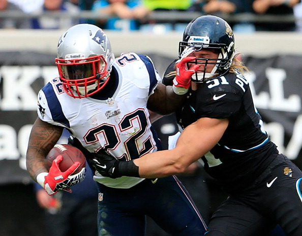 JACKSONVILLE, FL - DECEMBER 23:  Stevan Ridley #22 of the New England Patriots is tackled by  Paul Posluszny #51 of the Jacksonville Jaguars during the game at EverBank Field on December 23, 2012 in Jacksonville, Florida.  (Photo by Sam Greenwood/Getty Images)