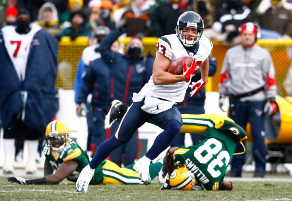 GREEN BAY, WI - DECEMBER 07: Wide receiver Kevin Walter #83 of the Houston Texans runs for a touchdown after a reception during the first quarter against the Green Bay Packers at Lambeau Field on December 7, 2008 in Green Bay, Wisconsin. (Photo by Jeff Gross/Getty Images)