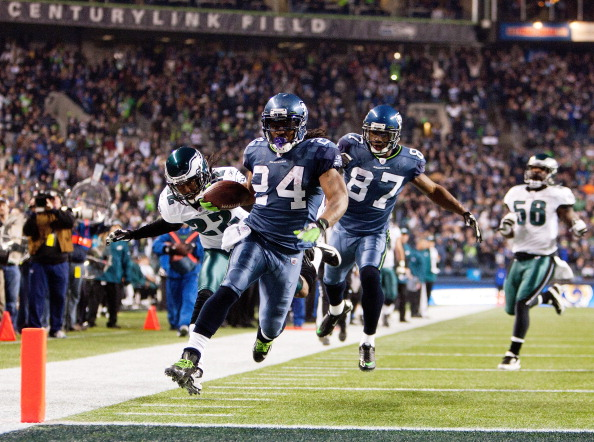 SEATTLE, WA - DECEMBER 1: Marshawn Lynch #24 of the Seattle Seahawks scores as he out runs Asante Samuel #22 of the Philadelphia Eagles at CenturyLink Field December 1, 2011 in Seattle, Washington. (Photo by Jay Drowns/Getty Images)