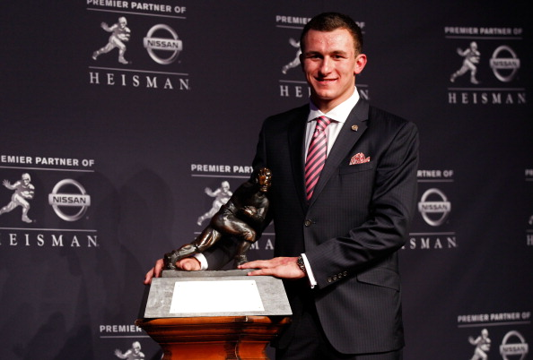 NEW YORK, NY - DECEMBER 08:  Quarterback Johnny Manziel of the Texas A&M University Aggies poses with the Heisman Memorial Trophy after being named the 78th Heisman Memorial Trophy Award winner at a press conference after at the Marriott Marquis on December 8, 2012 in New York City.  (Credit, Mike Stobe/Getty Images)