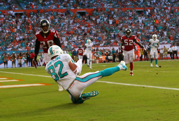 MIAMI GARDENS, FL - SEPTEMBER 22: Brian Hartline #82 of the Miami Dolphins catches a touchdown pass during a game against the Atlanta Falcons at Sun Life Stadium on September 22, 2013 in Miami Gardens, Florida.  (Photo by Mike Ehrmann/Getty Images)