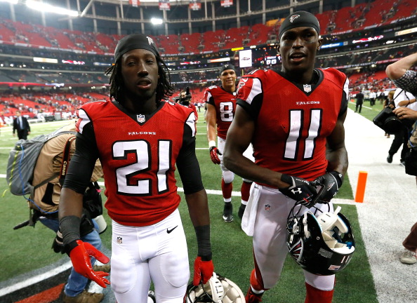 ATLANTA, GA - SEPTEMBER 15:  Desmond Trufant #21 and Julio Jones #11 of the Atlanta Falcons walk of the field after their 31-24 win over the St. Louis Rams at Georgia Dome on September 15, 2013 in Atlanta, Georgia.  (Photo by Kevin C. Cox/Getty Images)