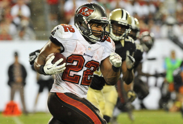 TAMPA, FL - SEPTEMBER 15:  Running back Doug Martin #22 of the Tampa Bay Buccaneers rushes upfield in the 4th quarter against the New Orleans Saints September 15, 2013 at Raymond James Stadium in Tampa, Florida. The Saints won 16  - 14.  (Photo by Al Messerschmidt/Getty Images)