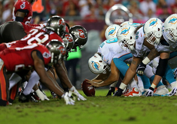 TAMPA, FL - NOVEMBER 11: The Miami Dolphins line up against the Tampa Bay Buccaneers during a game at Raymond James Stadium on November 11, 2013 in Tampa, Florida. (Photo by Mike Ehrmann/Getty Images)