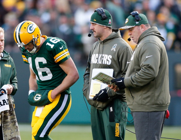 GREEN BAY, WI - NOVEMBER 10: Scott Tolzien #16 of the Green Bay Packers talks with Aaron Rodgers and head coach Mike McCarthy during a fourth quarter time out while playing the Philadelphia Eagles at Lambeau Field on November 10, 2013 in Green Bay, Wisconsin. Philadelphia won the game 27-13. (Photo by Gregory Shamus/Getty Images)