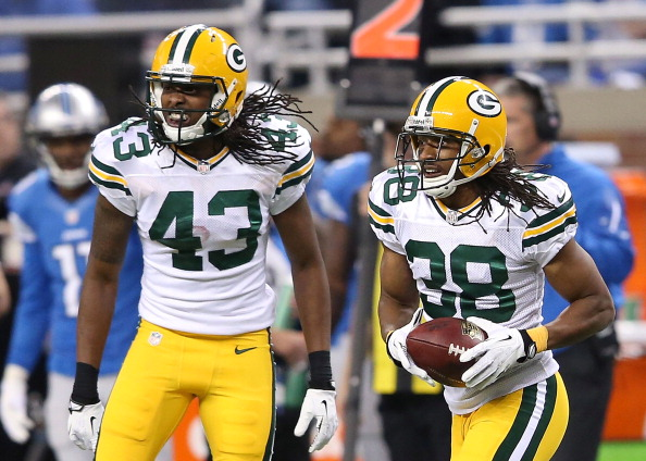 DETROIT, MI - NOVEMBER 28: Tarmon Williams #38 of the Green Bay Packers celebrates with team-mate M.D. Jennings after intercepting a pass from Matthew Stafford #9 of the Detroit Lions during the second quarter of the game at Ford Field on November 28, 2013 in Detroit, Michigan.  (Photo by Leon Halip/Getty Images)