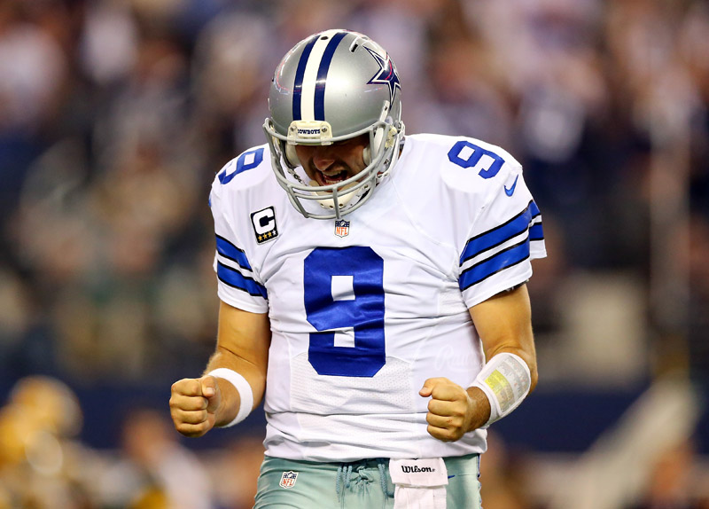 ARLINGTON, TX - DECEMBER 15:  Quarterback Tony Romo #9 of the Dallas Cowboys reacts against the Green Bay Packers during a game at AT&T Stadium on December 15, 2013 in Arlington, Texas.