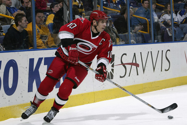 ST. LOUIS - OCTOBER 15:  Center Ron Francis #10 of the Carolina Hurricanes plays the puck behind the net against the St.Louis Blues during their NHL game on October 15, 2002 at the Savvis Center in St. Louis, Missouri. The Blues beat the Hurricanes 2-1 in overtime.