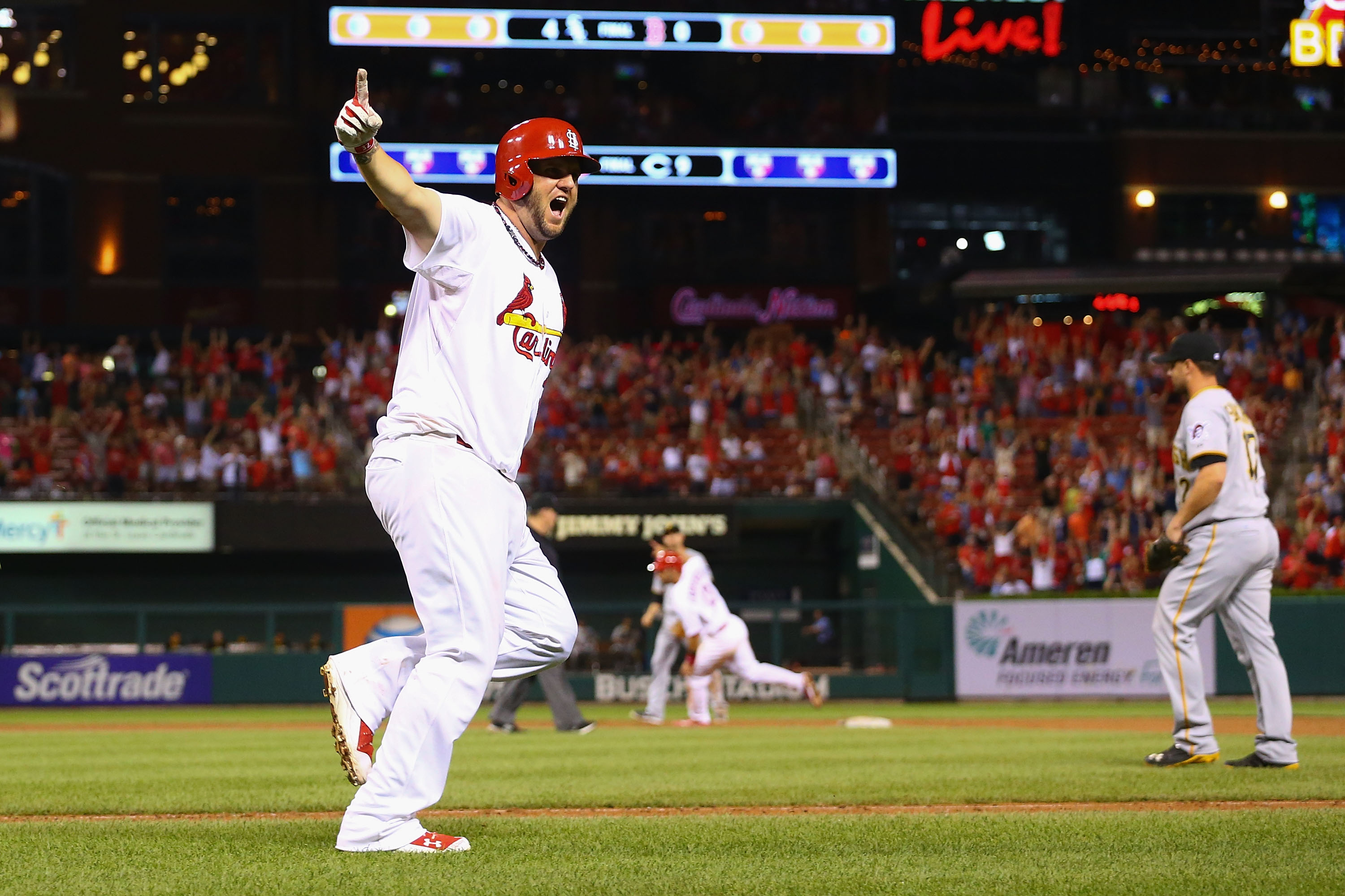 ST. LOUIS, MO - JULY 7: Matt Adams #32 of the St. Louis Cardinals celebrates after hitting a two-run walk-off home run against the Pittsburgh Pirates in the ninth inning at Busch Stadium on July 7, 2014 in St. Louis, Missouri.  The Cardinals beat the Pirates 2-0 with a walk-off home run.