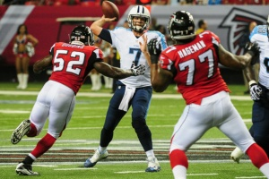 Tim Dobbins and Ra'Shede Hageman show Zach Mettenberger the pressures of the NFL. (Photo Credit: Scott Cunningham/Getty Images Sport)