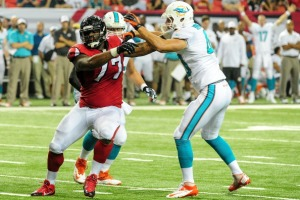 Ra'Shede Hageman disrupts the Miami Dolphins Offense.  (Photo Credit: Scott Cunningham/Getty Images Sport)