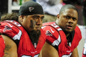 Paul Soliai and Corey Peters do not have a solution for the running attack of the Carolina Panthers. (Photo Credit: Scott Cunningham/Getty Images Sports)