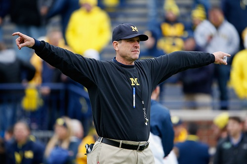 ANN ARBOR, MI - OCTOBER 17: Head coach Jim Harbaugh of the Michigan Wolverines directs his team during warm ups to the college football game against the Michigan State Spartans at Michigan Stadium on October 17, 2015 in Ann Arbor, Michigan. (Credit: Christian Petersen/Getty Images)