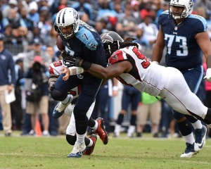 NASHVILLE, TN - OCTOBER 25: Quarterback Zach Mettenberger #7 of the Tennessee Titans is tackled after a run against the Atlanta Falcons during the first half at Nissan Stadium on October 25, 2015 in Nashville, Tennessee. (Photo by Frederick Breedon/Getty Images)