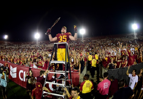 LOS ANGELES, CA - OCTOBER 24: Cameron Smith #35 of the USC Trojans celebrates a 42-24 win over the Utah Utes with fans after his three interception game at Los Angeles Memorial Coliseum on October 24, 2015 in Los Angeles, California. (Credit: Harry How/Getty Images)