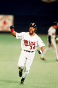 MINNEAPOLIS - OCTOBER 26: Kirby Puckett #34 of the Minnesota Twins celebrates as he rounds the bases after hitting the game winning home run in the eleven inning of the 1991 World Series against the Atlanta Braves at The Metrodome on October 26, 1991 in Minneapolis, Minnesota. The Twins won 4-3 and tie the series 3-3. (Credit: Ron Vesely/MLB Photos via Getty Images)