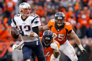 DENVER, CO - JANUARY 24: Tom Brady #12 of the New England Patriots looks to pass in the second half against the Denver Broncos in the AFC Championship game at Sports Authority Field at Mile High on January 24, 2016 in Denver, Colorado.  (Photo by Christian Petersen/Getty Images)