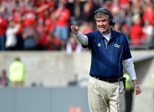 RALEIGH, NC - NOVEMBER 08: Head coach Paul Johnson of the Georgia Tech Yellow Jackets directs his team against the North Carolina State Wolfpack during their game at Carter-Finley Stadium on November 8, 2014 in Raleigh, North Carolina. (Photo by Grant Halverson/Getty Images)