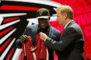 CHICAGO, IL - APRIL 28:  (L-R) Keanu Neal of Florida holds up a jersey with NFL Commissioner Roger Goodell after being picked #17 overall by the Atlanta Falcons during the first round of the 2016 NFL Draft at the Auditorium Theatre of Roosevelt University on April 28, 2016 in Chicago, Illinois.  (Photo by Jon Durr/Getty Images)