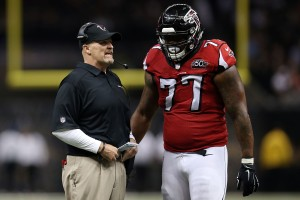 NEW ORLEANS, LA - OCTOBER 15: Head coach Dan Quinn of the Atlanta Falcons speaks with Ra'Shede Hageman #77 during the fourth quarter of a game against the New Orleans Saints at the Mercedes-Benz Superdome on October 15, 2015 in New Orleans, Louisiana. (Photo by Chris Graythen/Getty Images)