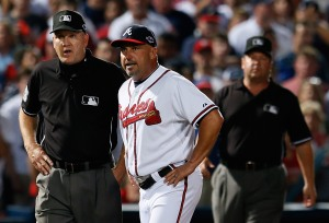 ATLANTA, GA - OCTOBER 05: Manager Fredi Gonzalez #33 of the Atlanta Braves argues an infield fly ruling in the eighth inning with third base umpire Jeff Nelson and left field umpire Sam Holbrook while taking on the St. Louis Cardinals during the National League Wild Card playoff game at Turner Field on October 5, 2012 in Atlanta, Georgia. (Photo by Kevin C. Cox/Getty Images)
