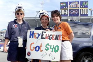 MIAMI, UNITED STATES: Fans show support for the Denver Broncos outside Pro Player Stadium just hours before the start of Super Bowl XXXIII 31 January in Miami, FL. The defending champion Denver Broncos will face the Atlanta Falcons. From left are: Sarah Hoyt of Colorado Springs, CO, Vicki Lovato from Phoenix, AZ, and Michelle Peter from Charleston, SC. The sign the trio holds refers to Atlanta Falcons player Eugene Robinson who was arrested late 30 January after allegedly offering an undercover policewoman, who was posing as a prostitute, 40 USD for oral sex. (ELECTRONIC IMAGE) AFP PHOTO/Rhona WISE (Photo credit should read RHONA WISE/AFP/Getty Images)