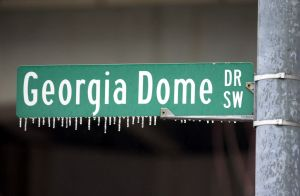 ATLANTA, GA - JANUARY 29: Icicles clings from a street sign in front of the Georgia Dome after an ice storm in the Atlanta area early 29 January 2000. The St. Louis Rams will face the Tennessee Titans in SuperBowl XXXIV on 30 January 2000. (ELECTRONIC IMAGE) (Photo credit should read TONY RANZE/AFP/Getty Images)