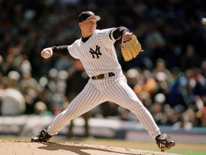 David Cone of the New York Yankees in action against the Texas Rangers. Credit: Al Bello/ALLSPORT