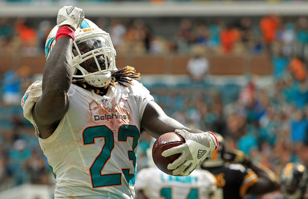 Jay Ajayi #23 of the Miami Dolphins celebrates a touchdown during a game against the Pittsburgh Steelers on October 16, 2016 in Miami Gardens, Florida.