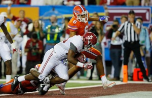 Joshua Jacobs #25 of the Alabama Crimson Tide scores a second quarter touchdown against the Florida Gators during the SEC Championship game (Photo by Kevin C. Cox/Getty Images)