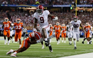 Bo Scarbrough #9 of the Alabama Crimson Tide leaps over the tackle of Chauncey Gardner #23 of the Florida Gators in the third quarter during the SEC Championship game (Photo by Kevin C. Cox/Getty Images)