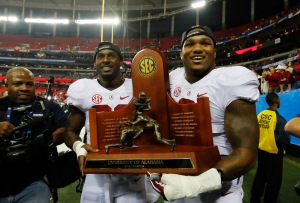 Rashaan Evans #32 and Da'Shawn Hand #9 of the Alabama Crimson Tide celebrate their 54 to 16 win over the Florida Gators during the SEC Championship game (Photo by Kevin C. Cox/Getty Images)