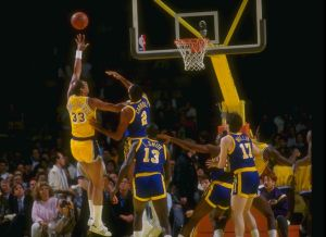 Kareem Abdul-Jabbar goes up for a shot against Joe Barry Carroll and the Golden State Warriors in 1986. (Getty Images).
