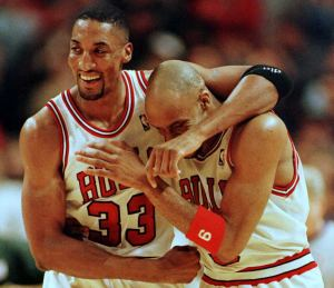 Scottie Pippen (L) and Ron Harper of the Chicago Bulls embrace at the end a victory against the Miami Heat (Credit: BRIAN BAHR/AFP/Getty Images)