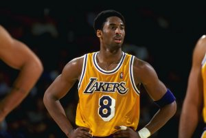 Kobe Bryant #8 of the Los Angeles Lakers looks on from the court during a game against Portland in 1999 (Getty Images)
